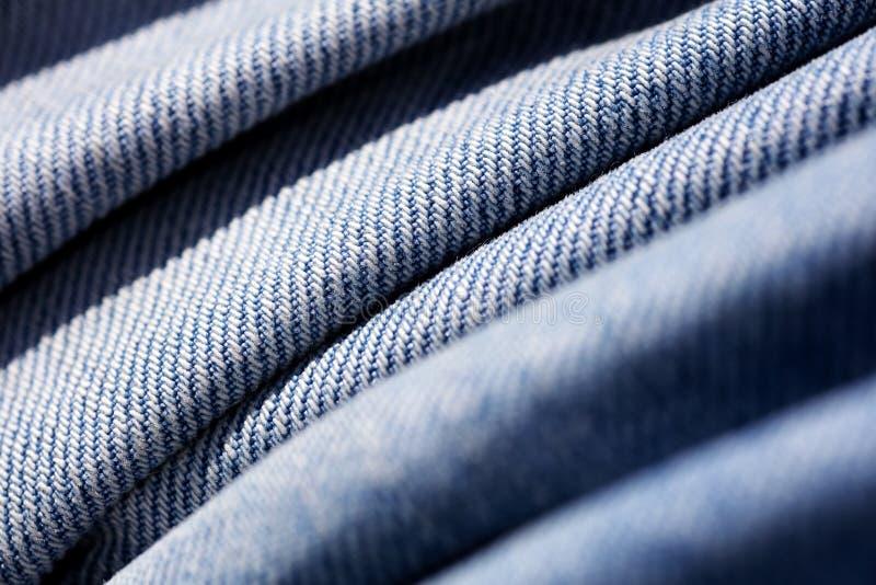 Belas artes macro extremas do fundo das fibras da roupa de cal?as de ganga nos produtos de alta qualidade 50,6 Megapixels das c?p fotografia de stock