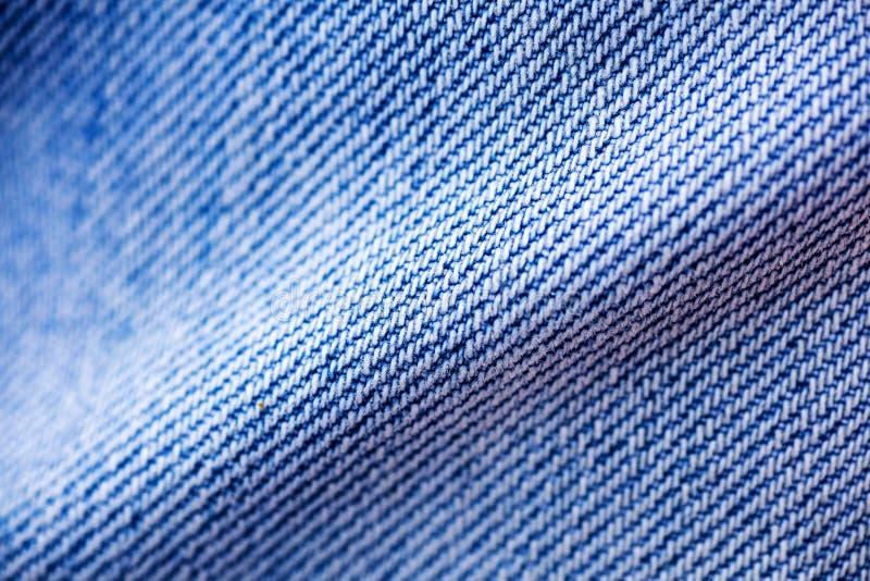 Belas artes macro extremas do fundo das fibras da roupa de cal?as de ganga nos produtos de alta qualidade 50,6 Megapixels das c?p foto de stock