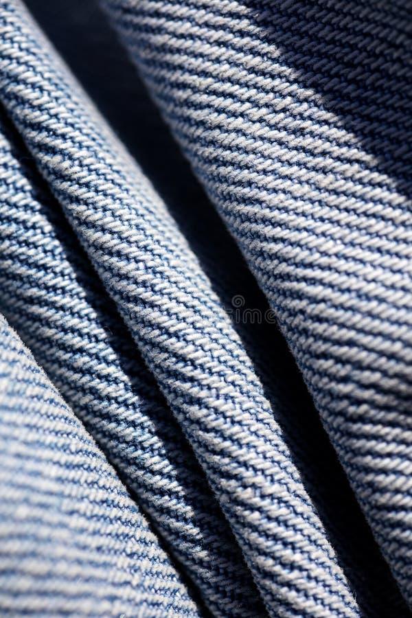 Belas artes macro extremas do fundo das fibras da roupa de cal?as de ganga nos produtos de alta qualidade 50,6 Megapixels das c?p imagem de stock