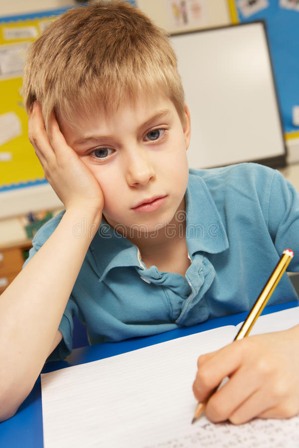 belastat studera för klassrum schoolboy fotografering för bildbyråer