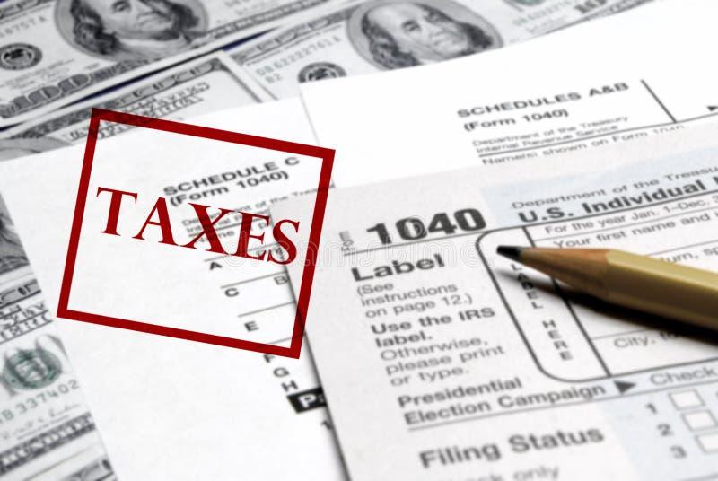 Belastingenvormen en Geld stock foto's