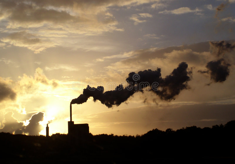 Belching smoke. Industrial chimneys stock photos