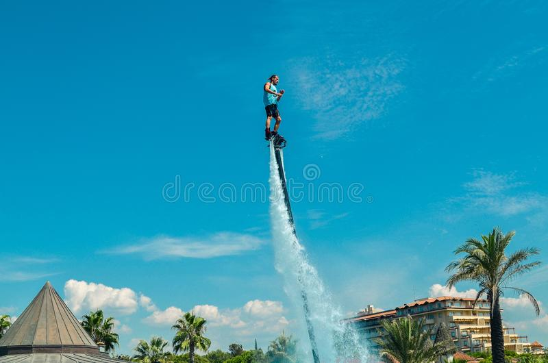 Belek, Turkey - September 12, 2018. Exciting fly board watershow at the pool party. Summer vacation fun sport concept royalty free stock photos