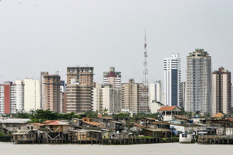 Belem: modern buildings and stilt houses on river Guama. Modern buildings and stilt houses on the Guama river. Stark contrast to the social inequality between royalty free stock image