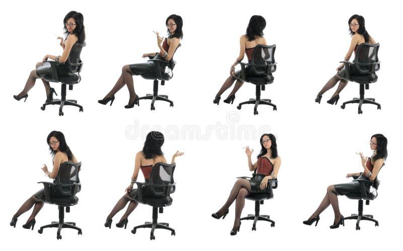A beleza do escritório está sentando-se na cadeira| Isolado fotografia de stock