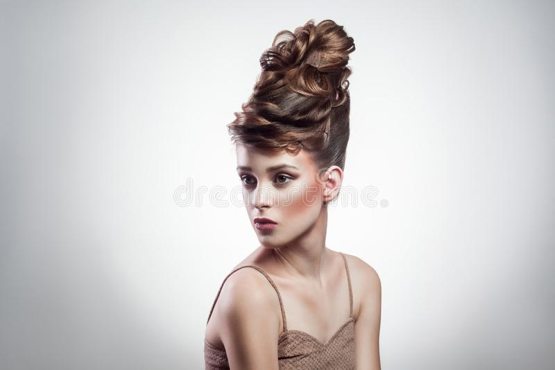 Beleza e penteado fêmeas da composição fotos de stock