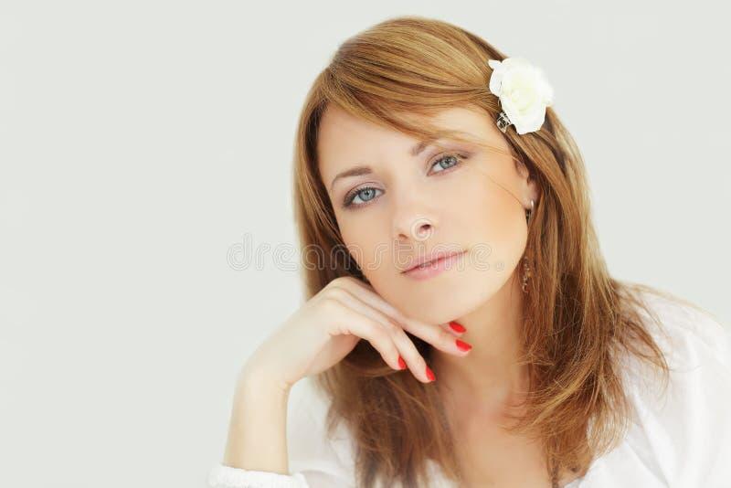 Beleza - face fêmea de sorriso fotografia de stock