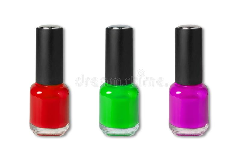 Beleza, forma e arte do prego Ferramentas cosméticas da arte do tratamento de mãos, três garrafas do verniz para as unhas colorid fotos de stock