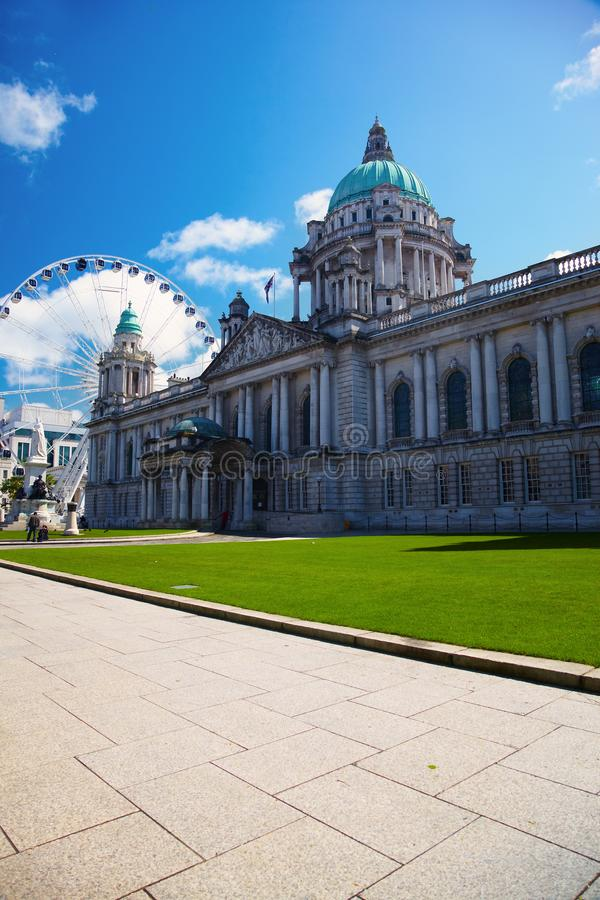 Belfast City Hall and Ferris wheel stock images