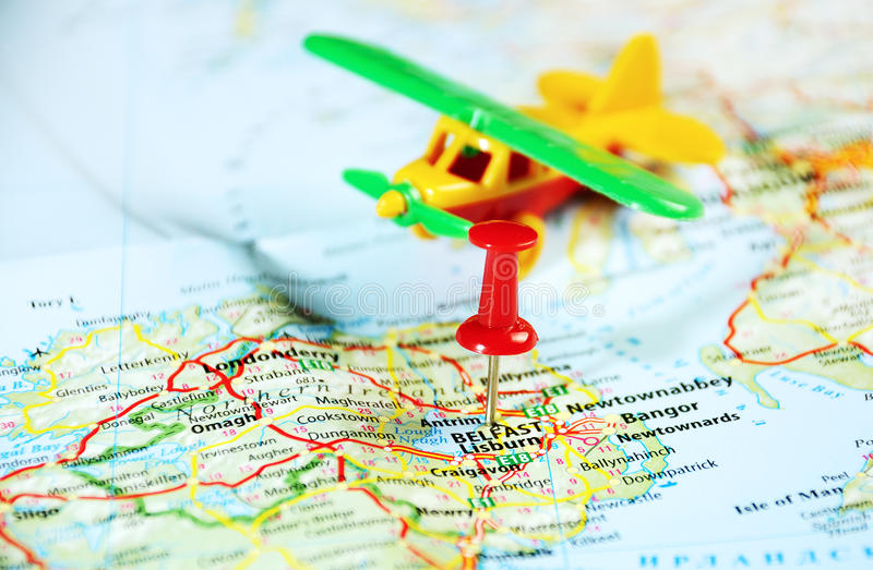 Belfast Ireland ,United Kingdom map airplane. And pin - Travel concept royalty free stock photo