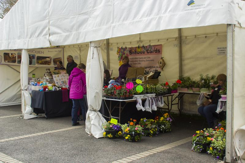 Belfast Northern Ireland Small traders and customers in their marquees at the Belfast Spring Festival as trading gri. 22 April 2018 Belfast Northern Ireland royalty free stock image