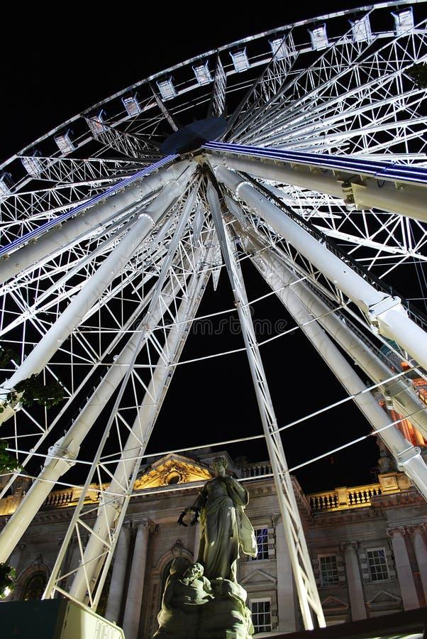 Belfast Wheel. Belfast City Hall at night stock photography