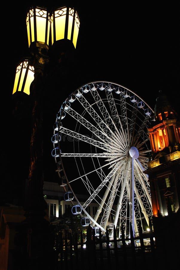 Belfast Wheel at night. Belfast Wheel, Belfast City Hall at night stock images