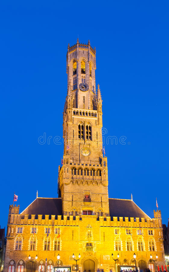 Belfort. Night view of a medieval belfry tower in Bruges, Belgium stock photo