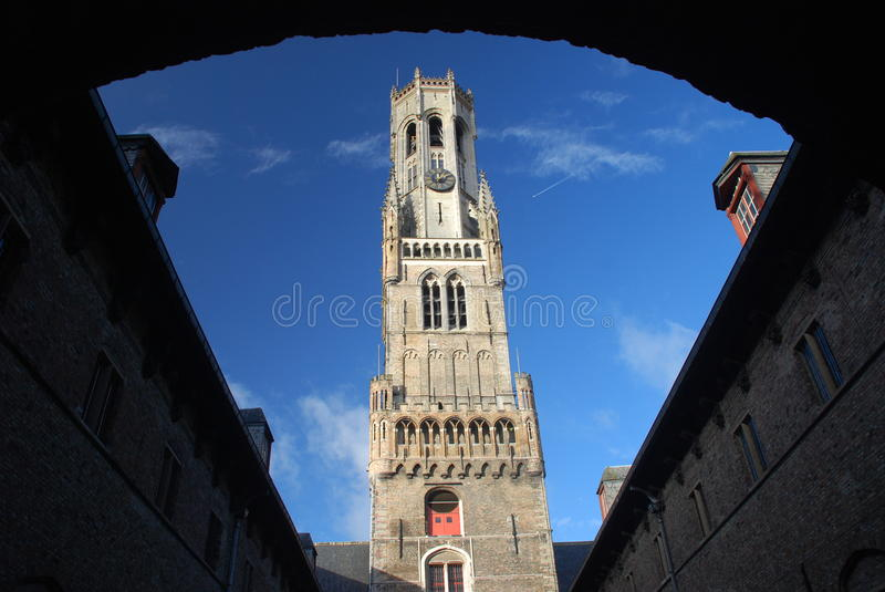 Belfort (Belfry of Bruges) in a sunny afternoon, Bruges, Belgium. The belfry of Bruges, or Belfort, the medieval bell tower in the historical centre of Bruges royalty free stock images