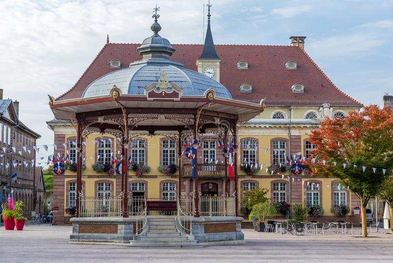 BELFORT, FRANCE - SEPTEMBER 30, 2017: Central square and city hall of Belfort. Colorful central square and city hall of Belfort stock photos