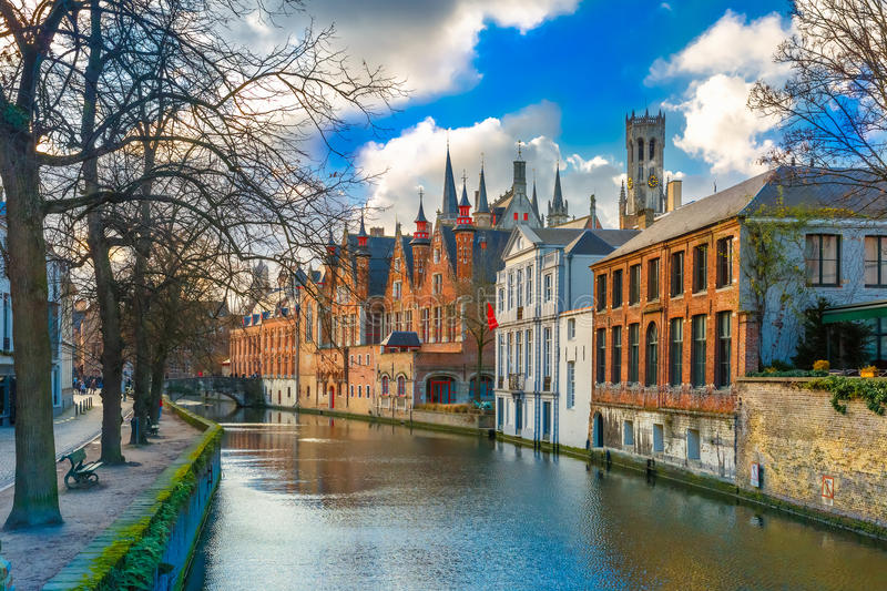 Belfort and the Green canal in Bruges, Belgium. Scenic cityscape with a medieval tower Belfort and the Green canal, Groenerei, in Bruges, Belgium stock images