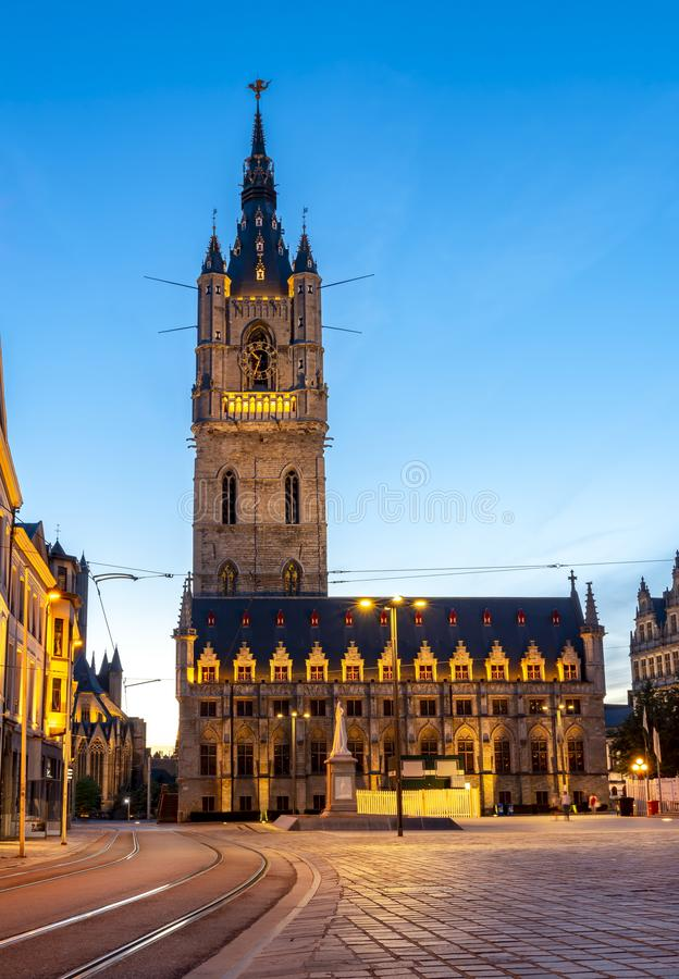 Belfort tower on St. Bavo square at night, Gent, Belgium stock photography
