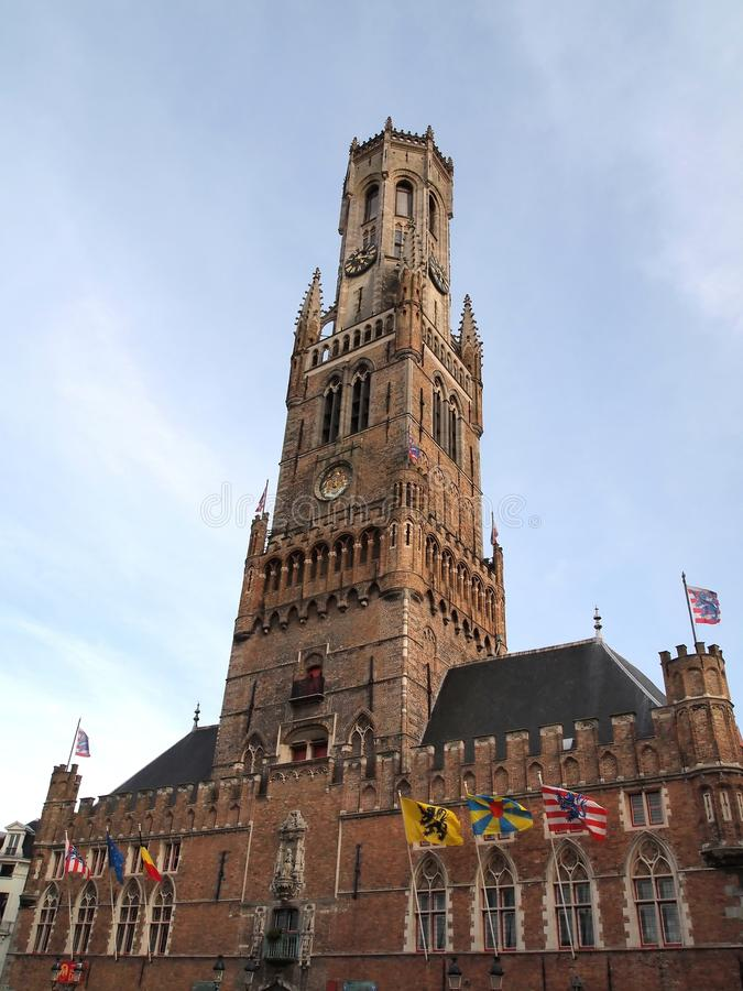 The Belfry or Belfort of Bruges , Belgium. The belfry of Bruges, or Belfort, is a medieval bell tower in the historical center of Bruges, Belgium. One of the stock photography