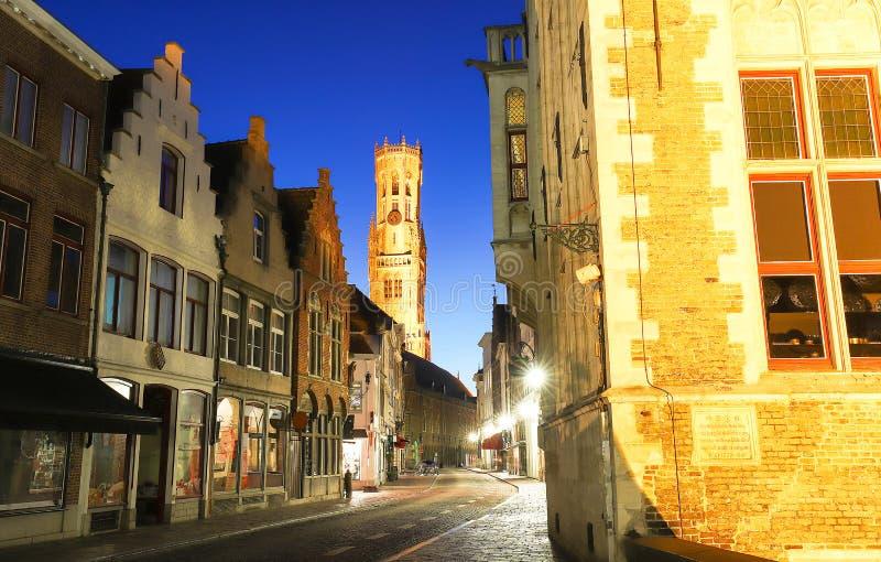 Belfry of Bruges and night street Bruges, Flemish Region, Belgium stock image