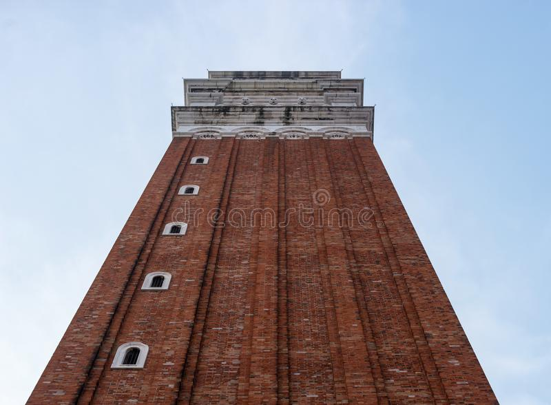 Belfry of St. Mark`s Basilica in Venice, Italy.Campanile di San Marco in Italian. Photographed from below along the wall stock photo