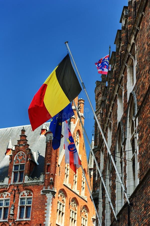 Belgare-, europé- och Bruges flaggor arkivbilder