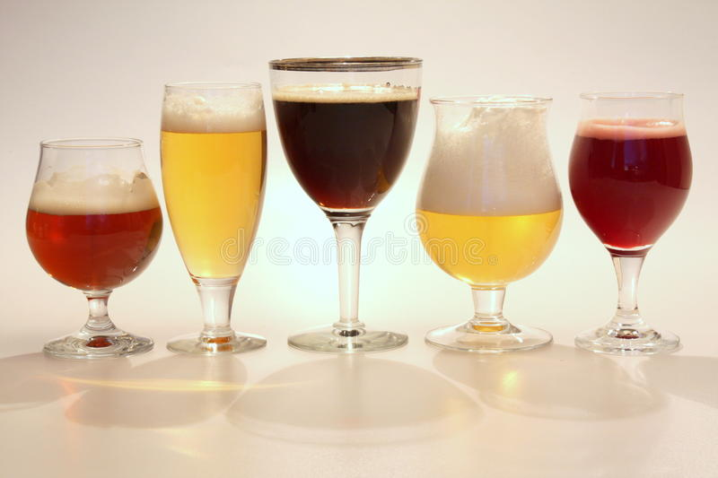 Belgian beer. Styles with their own branded glasses stock images