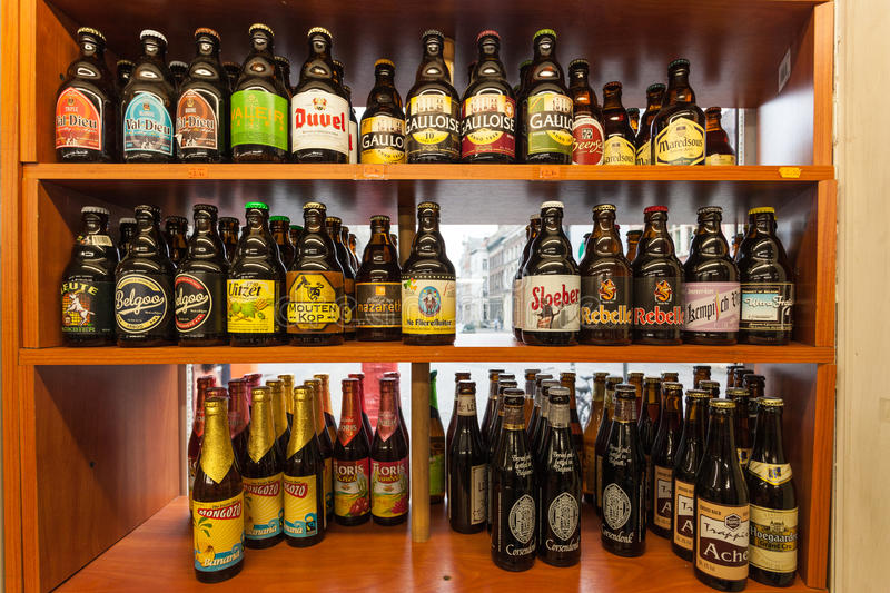 Belgian beer in a shop. GHENT, BELGIUM - AUG 23: Selection of traditional belgian beer in a small shop in Ghent. August 23, 2015 in Ghent, Belgium royalty free stock photography