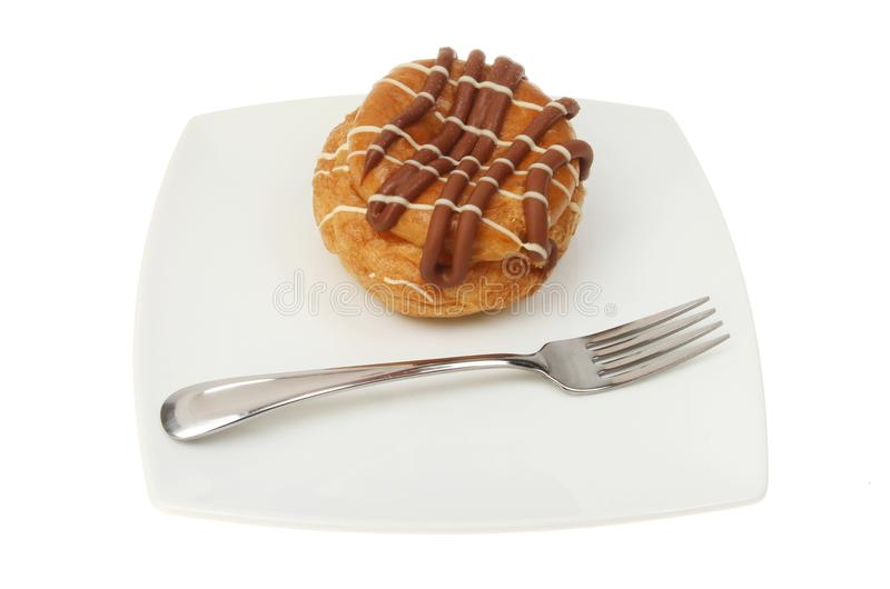Download Choux bun on a plate stock image. Image of white, fork - 105387491