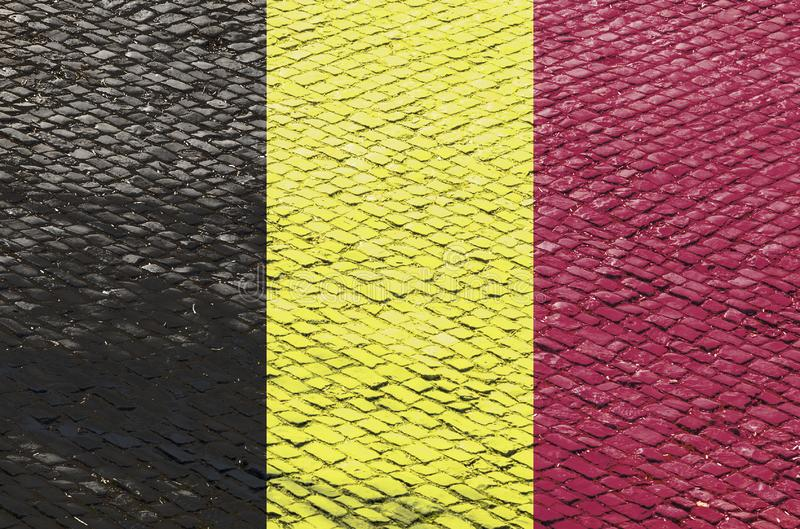 Belgian Flag on a Cobblestone Road Pattern. Abstract image of a Belgian flag blended with a real cobblestone road pattern. Image related to the famous French stock illustration