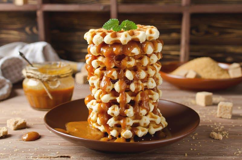 Belgian sugar waffles with caramel sauce royalty free stock photography