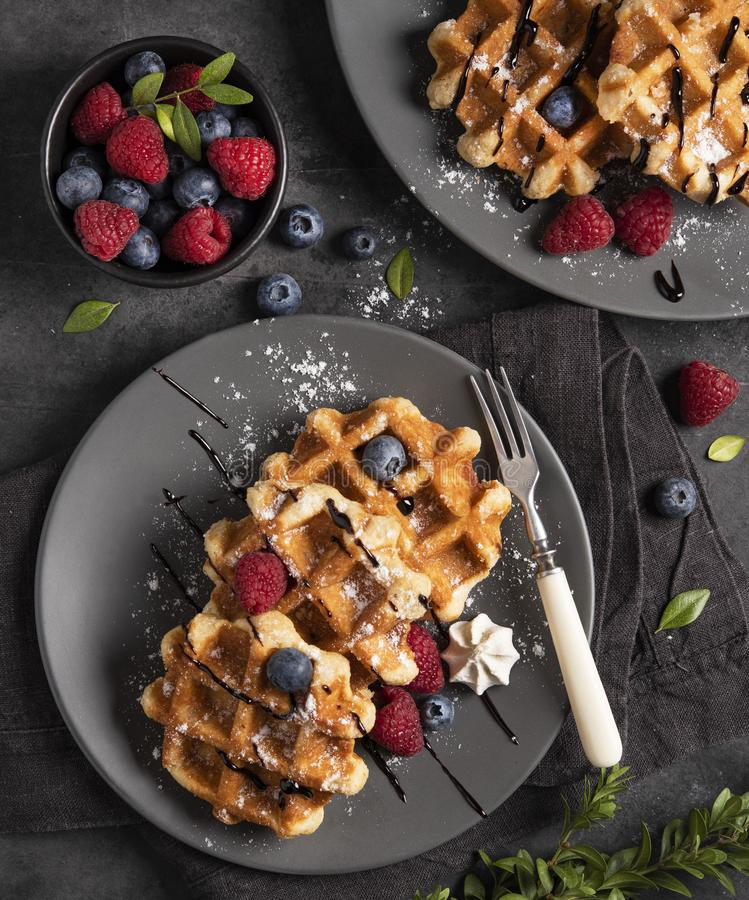 Belgian waffels berries raspberry blueberry top view. Yummy sweet homemade cooking crepes royalty free stock image