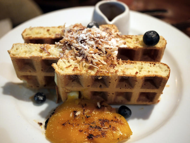 Belgian Waffle. Waffle with blueberries and mango sauce stock photo