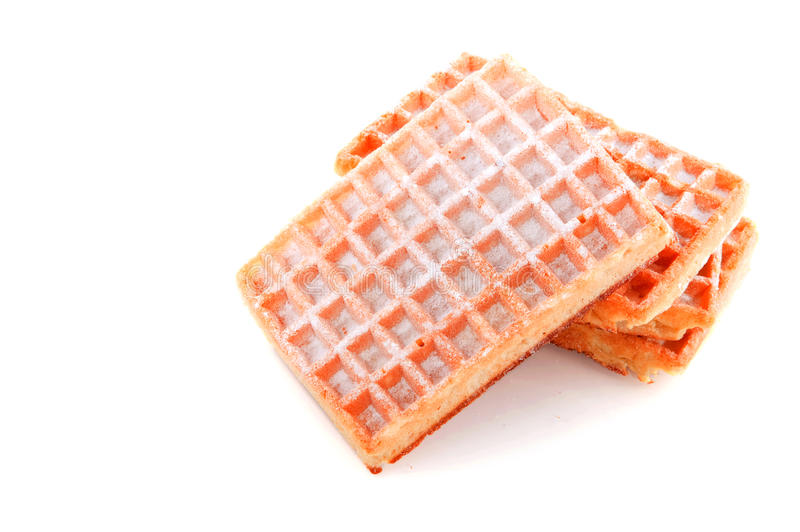Belgian waffles. Belgian traditional sweet waffles isolated over white royalty free stock photography