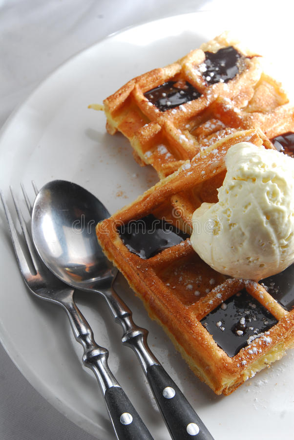Belgian Waffles. Whipped cream and chocolate sauce waffles royalty free stock photo