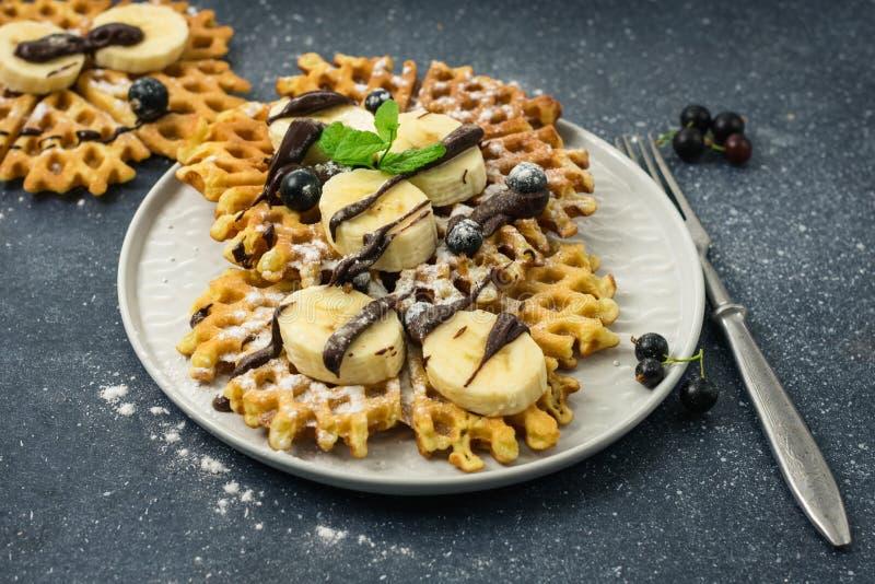 Belgian waffles. Homemade traditional Belgian waffles with chocolate and banana stock photos