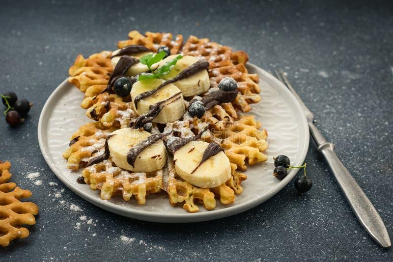 Belgian waffles. Homemade traditional Belgian waffles with chocolate and banana stock photo