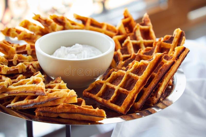 Belgian waffles on metallic plate stock photography