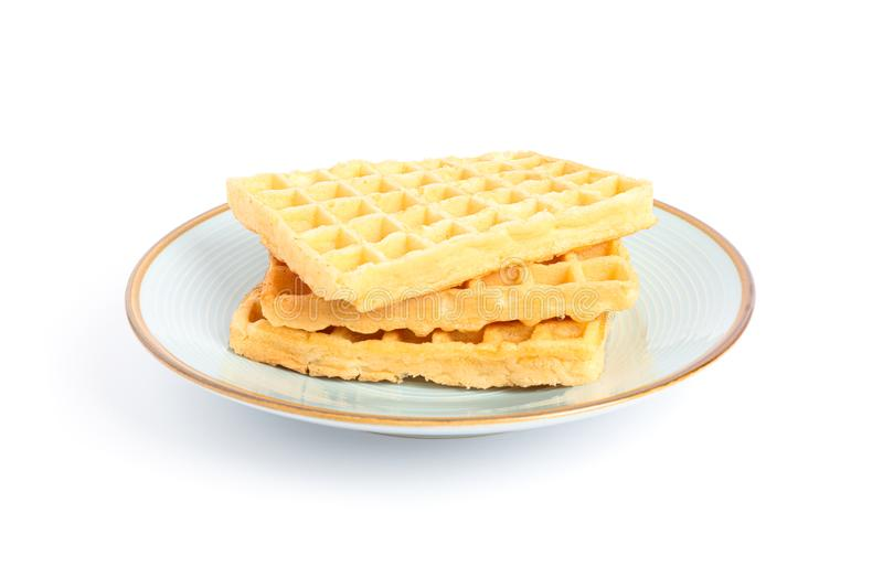 Belgian waffles on plate isolated. On white background royalty free stock photography