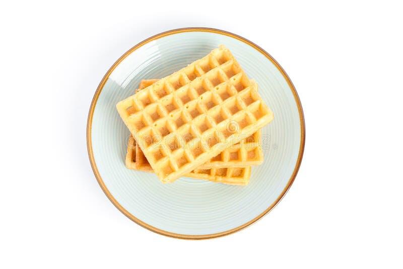 Belgian waffles on plate isolated. On white background royalty free stock photos