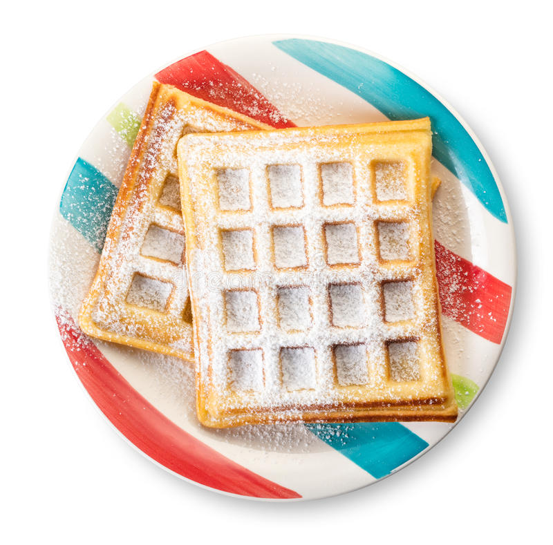 Belgian waffles with powdered sugar. On a white isolated background stock images