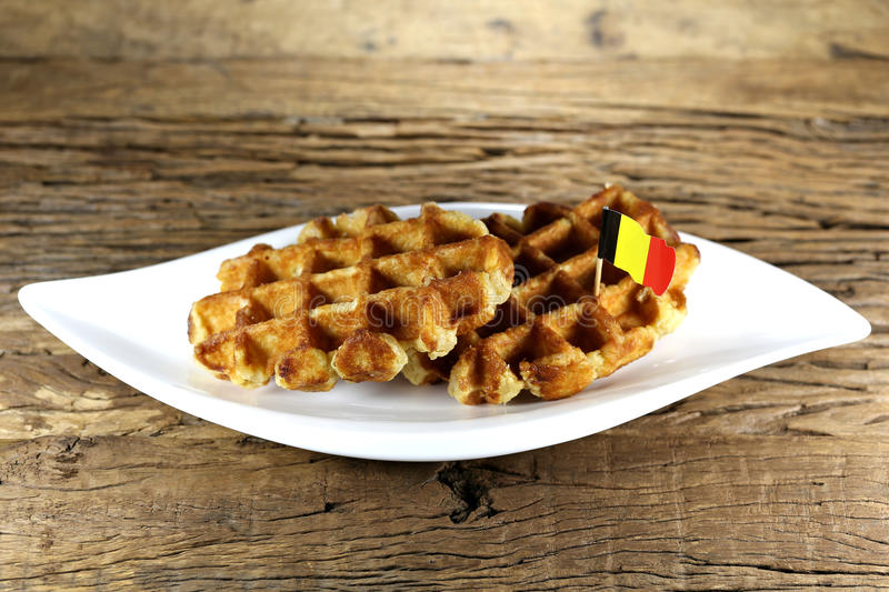 Belgian waffles. Served on a ceramic plate on rustic wooden background royalty free stock photos