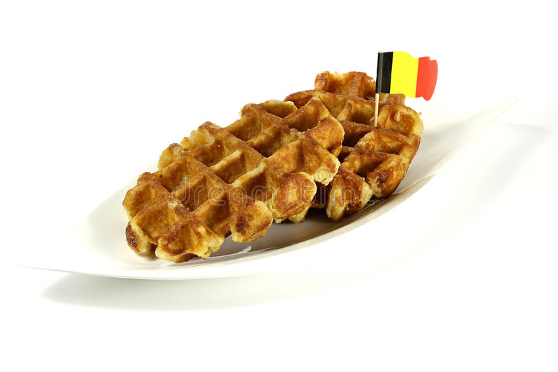 Belgian waffles. Served on a ceramic plate on white background royalty free stock photo