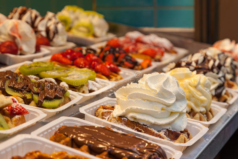 Belgian waffles with several toppings stock image