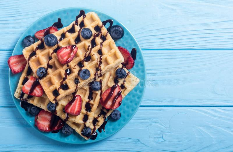 Belgian waffles with strawberry and blueberry royalty free stock photo