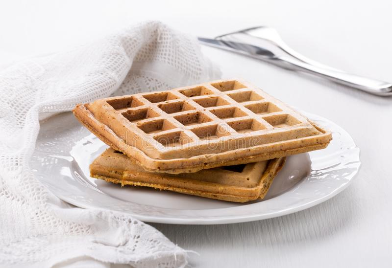 Belgian waffles on a white plate. Close-up royalty free stock photos