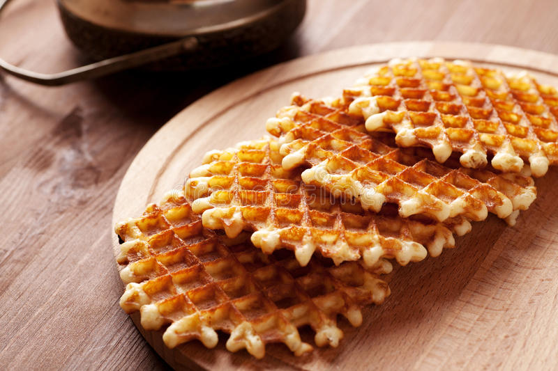 Belgian waffles on wooden table. Close-up macro shot royalty free stock images