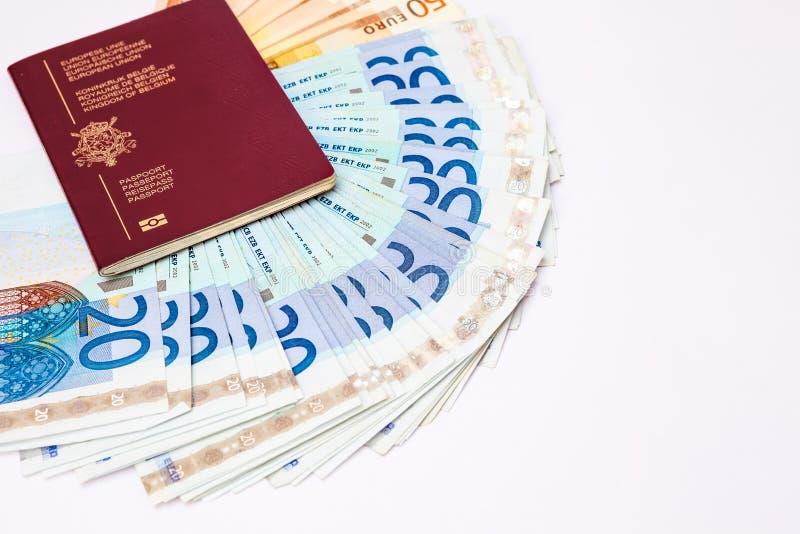 Belgien resande pass och euro` s royaltyfri bild