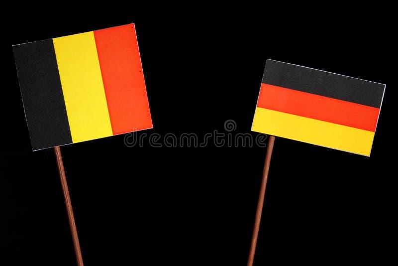 Download Belgische Flagge Mit Der Deutschen Flagge Lokalisiert Auf Schwarzem Stockbild - Bild von schwarzes, geld: 96934235