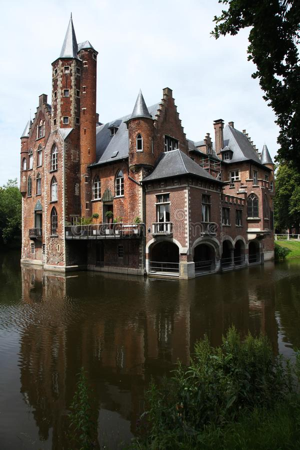 Belgium castle towers. Middle ages castle reflected in the water royalty free stock images